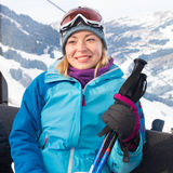 Female skier in gondola. Royalty Free Stock Images