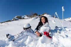 Female Skier with Helmet Enjoying Warm Sunshine Royalty Free Stock Images