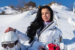Female Skier with Helmet Enjoying Warm Sunshine Stock Images