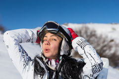 Female Skier in Helmet and Goggles on Sunny Day Stock Image
