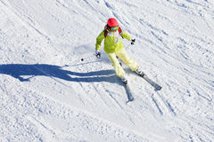 Female skier hitting the slopes at sunny day stock images