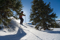 Female skier jumping royalty free stock photography