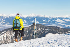 Female skier looking at landscape from the top of a mountain Royalty Free Stock Photos