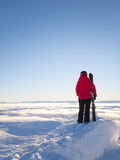 Female skier looking out over cloud covered valley Stock Images