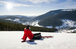 Female skier lying on snow, High mountain Stock Photos