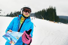 Female skier with map Stock Image