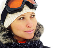 Female skier in mask. Young smiling female skier isolated on white Stock Photography