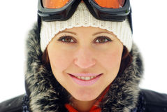Female skier in mask. Young smiling female skier isolated on white Royalty Free Stock Image