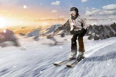 Skier rides downhill with high speed Stock Photo