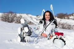 Female Skier Sitting and Enjoying Warm Sunshine Stock Image