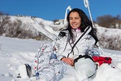 Female Skier Sitting and Enjoying Warm Sunshine Royalty Free Stock Images