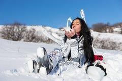 Female Skier Sitting and Enjoying Warm Sunshine Royalty Free Stock Photos
