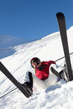 Female Skier Sitting In Snow Royalty Free Stock Photo