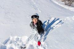 Female Skier Sitting on Sunny Snowy Mountainside Stock Photos