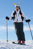 Female skier skiing downhill Stock Photo