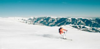 Female Skier skiing in mountain ski resort. Winter sport recreational activity Stock Photography