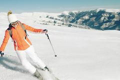 Female Skier skiing in mountain ski resort. Winter sport recreational activity. Outdoors Royalty Free Stock Images