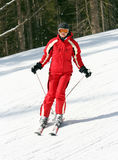 Female skier on a slope stock photos