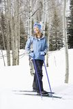 Female skier on slope. Royalty Free Stock Image