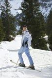 Female Skier Standing On Ski Slope Stock Image