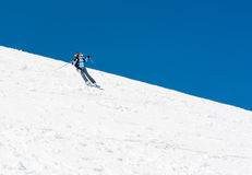 Female skier tackling a steep slope. Ski touring in the mountains Stock Photo