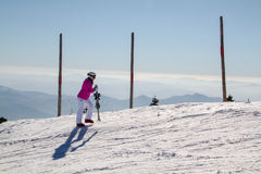 Female skier  at  the top of the mountain. Female skier at  the top of the mountain royalty free stock image