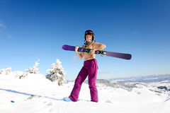 Female skier topless standing on the heel Royalty Free Stock Image
