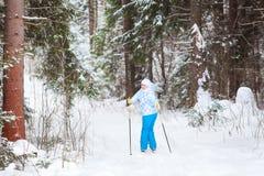 Female skier turning back when skiing Stock Image