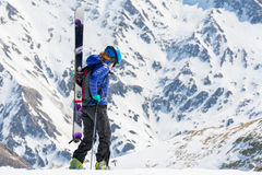 Female skier walking and looking down Royalty Free Stock Images
