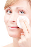 Female skin care face cleaning. Female in bothroom claening face skin with batting cotton pads Royalty Free Stock Photos