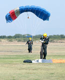Female skydiver making safe landing on grass with open brightly. RUSTENBURG, SOUTH AFRICA - April 28, 2017: National Skydiving Championships. Female skydiver Royalty Free Stock Image