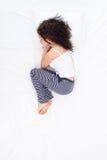 Female sleeping Foetus pose Stock Image