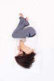 Female sleeping Foetus pose Royalty Free Stock Photography