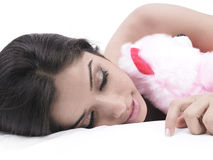 Female sleeping with her teddy Royalty Free Stock Image