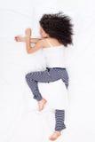 Female sleeping Log pose Stock Photo