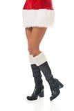 Female slim legs in santa boots Royalty Free Stock Photo