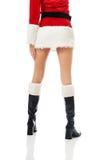 Female slim legs in santa boots Stock Photo