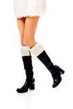 Female slim legs in santa boots Royalty Free Stock Photos