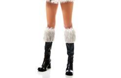 Female slim legs in santa boots Stock Photos