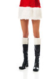 Female slim legs in santa boots Royalty Free Stock Photo