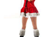 Female slim legs in santa boots Royalty Free Stock Image