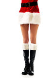Female slim legs in santa boots royalty free stock photography