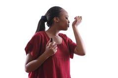 Female smelling perfume Stock Image