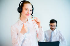 Female smiling call center operator Stock Photography