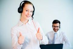 Female smiling call center operator Stock Image