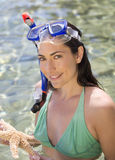 A female snorkeler holding a starfish Stock Image