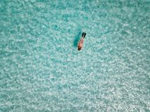Female snorkeler in turquoise waters. exuma bahamas stock images
