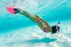 Female snorkeling. On tropical vacation in pink bikini Royalty Free Stock Photos
