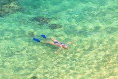 Female snorkeling in Hawaii stock photography