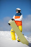 Female snowboarder against sun and sky Stock Photo